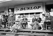 20/08/1967<br /> 08/20/1967<br /> 20 August 1967<br /> Irish Dunlop &pound;1,000 Tournament at Tramore Golf Club, Co. Waterford. Mr. John R. Sheridan (on left), Marketing Director, Irish Dunlop Co., speaking at the rize giving after the competition with (l-r): Mr. J. Kelly, Captain, I.P.G.A.; Mr. Barry Brian, Honorary Secretary, I.P.G.A.; Mr. Sheridan; Mrs John R. Sheridan; Dr. R.F. O'Driscoll, Captain of Tramore Golf Club; Mrs R.F. O'Driscoll; Mr. W.G. Robertson, President, I.P.G.A.; Miss Ann Diver, Lady Captain, Tramore Golf Club and Mr Cyril Kemp, Sports Sales Manager, Irish Dunlop Company.
