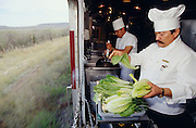 "South Orient Express Chef Juan Banos preparing lunch ""with a view""."
