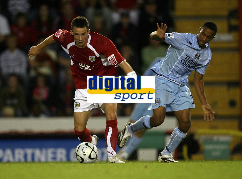 Photo: Rich Eaton.<br /> <br /> Bristol City v Manchester City. Carling Cup. 29/08/2007. Bristol City's Michael McIndoe shields the ball from Shalem Logan of Man City.