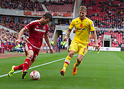 David Nugent (Middlesbrough FC) dribbles around Kyle McFadzean (Milton Keynes Dons) during the Sky Bet Championship match between Middlesbrough and Milton Keynes Dons at the Riverside Stadium, Middlesbrough, England on 12 September 2015. Photo by George Ledger.