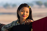Beautiful young girl road construction worker with clothes line, smiling, Mrauk U
