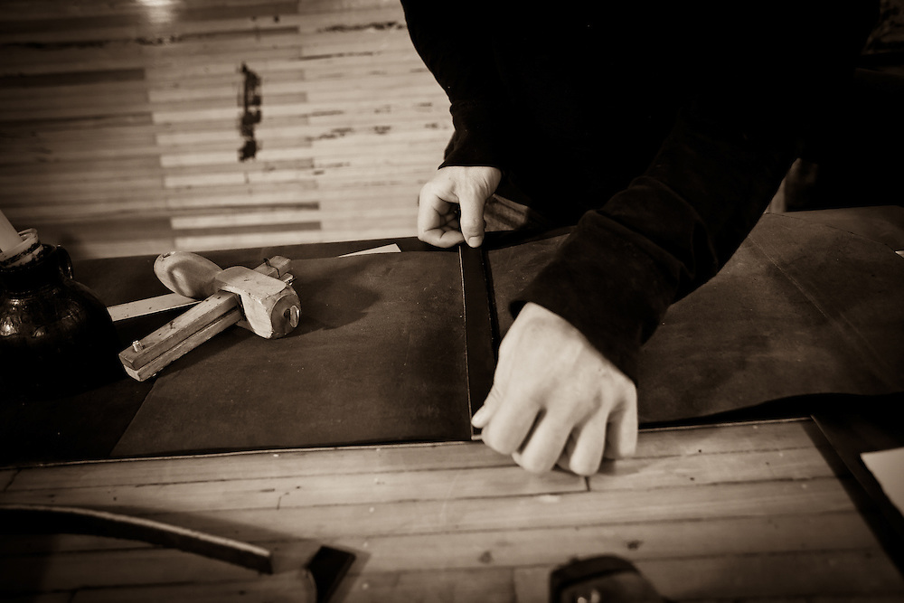 Allen Wagoner of Down Home Leather in Mt. Vernon, OH builds a custom leather photo portfolio for Zach Johnson.