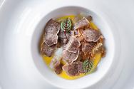 International White Truffle Fair, Alba, Piedmont   - Antipasto dish with fresh local tartufo bianco (white truffle) with eggs - prepared at Ristorante Da Francesco, Cherasco, near Alba in Le Langhe area of Piedmont