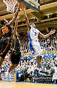 Duke Blue Devils guard Nolan Smith (2) goes up for a lay in only to have shot blocked by Maryland Terrapins forward Dino Gregory (33). Duke beats Maryland 71-64 at Cameron Indoor Stadium