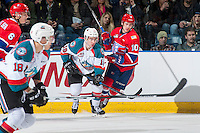 KELOWNA, CANADA - FEBRUARY 17: Ethan McIndoe #10 of the Spokane Chiefs checks Dillon Dube #19 of the Kelowna Rockets during first period on February 17, 2017 at Prospera Place in Kelowna, British Columbia, Canada.  (Photo by Marissa Baecker/Shoot the Breeze)  *** Local Caption ***