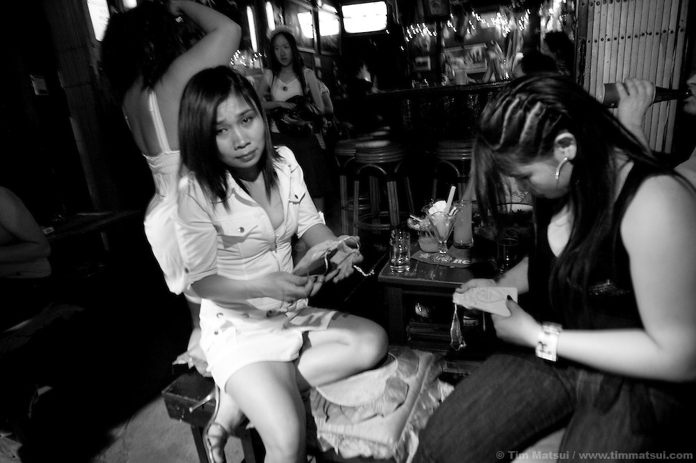 "Bar girls and sex workers receive Empower-branded condoms on Valentine's Day from Empower members in Chiang Mai, Thailand. Run by sex workers, Empower has a drop-in center offering computer and informal English training, health education, counseling and other support to sex workers. Founded in 1985 the organization has five centers from Phuket to Mai Sai and advocates for recognition, equality, and basic human rights for sex workers in Thai society where sex work is common, visible, and yet illegal..>>.Empower Chiang Mai opened the ""Can-Do"" bar which offers fair working conditions to sex workers by complying with all Thai Labor Laws and the recommended occupational health and safety standards..>>.Empower, which works with women over 18 years-old and is a vocal opponent of human trafficking, sexual or labor exploitation of any person,  is also campaigning to change the methods of anti-human trafficking groups. Empower states ""the focus on trafficking in persons has meant many groups with little or no experience on the issues of migration, labor, sex work or women's rights have been created to take advantage of the large sums of money available to support anti-trafficking activities."".>>.Recommendations by sex workers, many who were Burmese, some who had been trafficked, and all who acknowledged enlisting an agent to migrate illegally into Thailand, stated among other things that ""The primary goal of prosecuting traffickers must be altered to a primary goal of assisting trafficked women and children...if trafficked women and children...are continually rescued and assisted, the use of trafficked women and children will become unprofitable...we are willing to work our illegal status leaves us with no recourse against exploitation by agents or employers...Anti-trafficking groups must work toward improving the human rights situation...Anti-trafficking dialogue and groups have yet to consider us as anti-trafficking workers and human rights defenders...The latest stance fro"