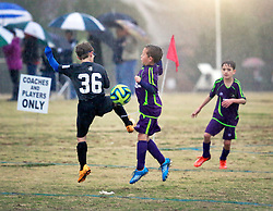 06 December 2014. Cumming Polo Fields, Georgia.<br /> Generation Adidas Norcross Cup.<br /> Jesters Elite U9 Purple team take on Concorde Fire Central U9 Black, losing 2-1 in the pouring rain.<br /> Photo; Charlie Varley/varleypix.com