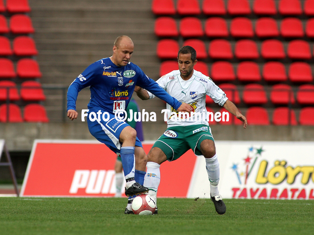 22.05.2006, Ratina, Tampere, Finland..Veikkausliiga 2006 - Finnish League 2006.Tampere United - IFK Mariehamn.Ville Lehtinen (TamU) v Erik Sandv?rn (IFKM).©Juha Tamminen.....ARK:k