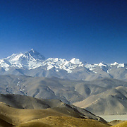 The North Face of Mount Everest rises from the foothills of the Tibetan Plateau as seen from the Pang La (Pass), Tibet, China.