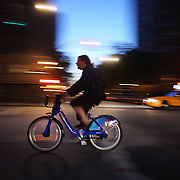 A Citi Bike user at night time in Chelsea, Manhattan, New York. Citi Bike the NYC Bicycle Share Program sponsored by Citi Bank, launched in late May 2013 giving access to thousands of bikes at docking stations throughout  Manhattan and parts of Brooklyn. Manhattan, New York, USA. 4th June 2013. Photo Tim Clayton