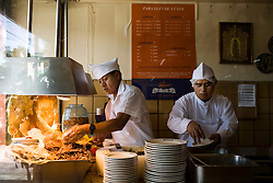 Men prepare carnitas and chicharones El Bajio, a well known restaurant in Mexico City for traditional mexican cuisine.