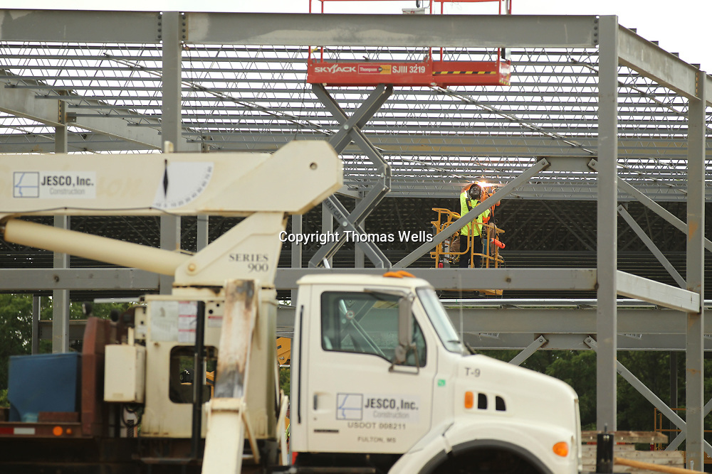 Wewlders continue to weld beams as construction of the new Barnes Crossing Kia is being built.