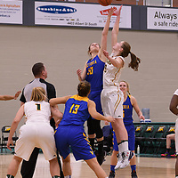 3rd year forward Christina McCusker (12) of the Regina Cougars in action during the home opener  on November  4 at Centre for Kinesiology, Health and Sport. Credit: /Arthur Images
