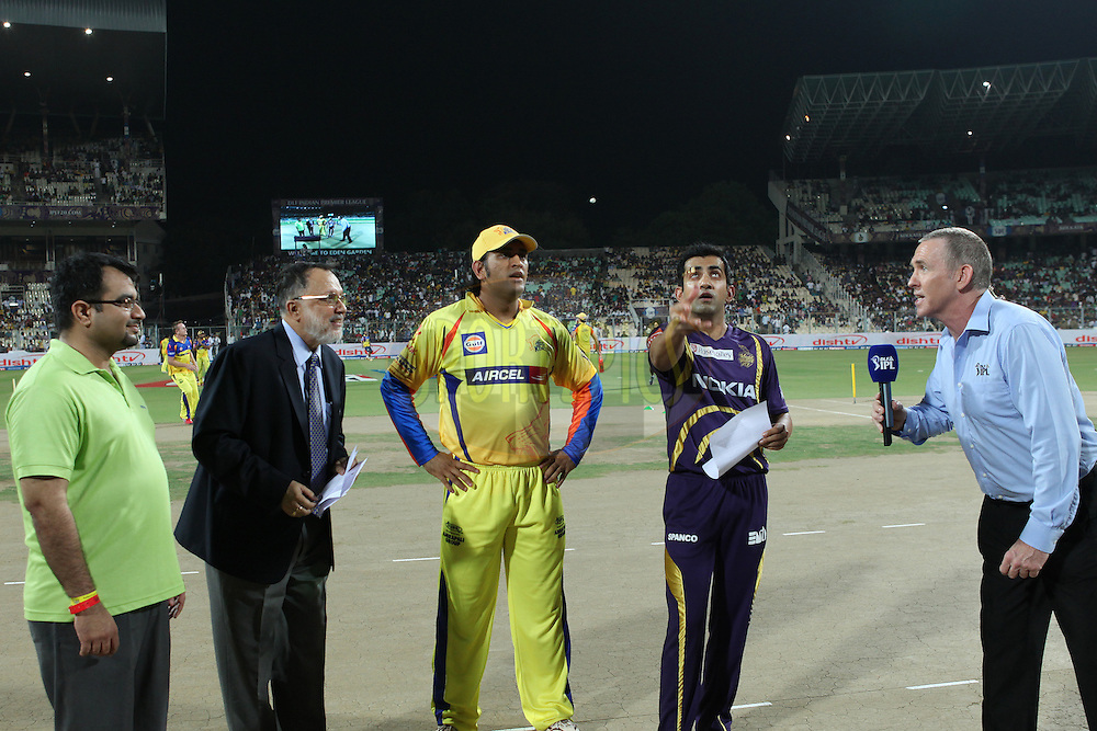 CSK Captain Dhoni and others watching the toss coin as KKR captain Gambhir flip the coin during match 63 of the the Indian Premier League ( IPL) 2012  between The Kolkata Knight Riders and The Chennai Superkings held at the Eden Gardens Stadium in Kolkata on the 14th May 2012..Photo by Saikat Das/IPL/SPORTZPICS