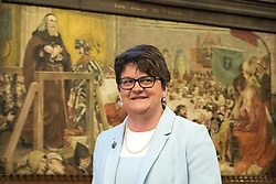 © Licensed to London News Pictures  . 03/10/2017 . Manchester , UK . ARLENE FOSTER MLA , leader of the Democratic Unionist Party ( DUP ) in front of Ford Madox Brown's The Trial of Wyclif mural , at a fringe event in the Great Hall in Manchester Town Hall during day three of the Conservative Party Conference at the Manchester Central Convention Centre . Photo credit : Joel Goodman/LNP