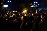 A crowd enjoys a DJ at the San Diego Street Scene Music Festival in San Diego, California on September 19, 2008.