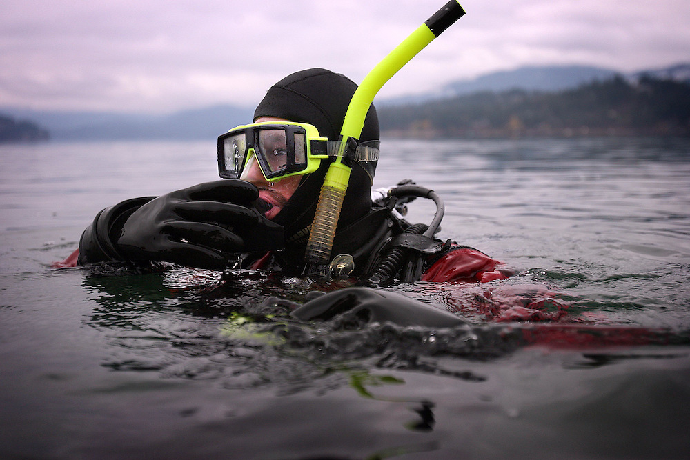 JEROME A. POLLOS/Press..Gary Mobbs, from the Hauser Lake Fire Department, prepares to practice cold water underwater rescue training with the Kootenai County Sheriff Department's dive team on Hayden Lake on Wednesday.