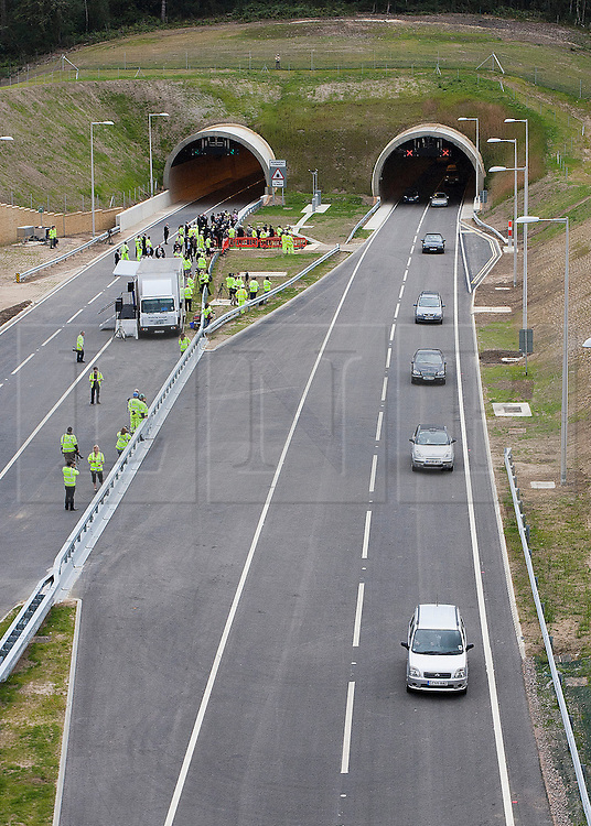 © Licensed to London News Pictures. 27/07/2011. Hindhead, Surrey, UK. Today (Wednesday) The £371 Million Hindhead Tunnel project officially opens to the public. Pictured: The first traffic comes through the Southern Portal. Photo credit: Sam Spickett/LNP