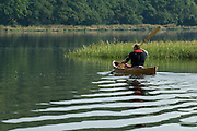 Paddling a canoe on the River Hamble. United Kingdom.