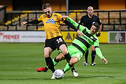 Forest Green Rovers Lloyd James(4) tangles with Cambridge United's George Maris(18) during the EFL Sky Bet League 2 match between Cambridge United and Forest Green Rovers at the Cambs Glass Stadium, Cambridge, England on 2 October 2018.