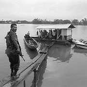 Police checkpoint on the Atrato River.