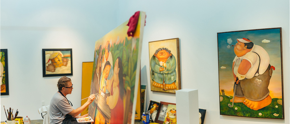 Portrait of Artist Alberto Godoy painting in his studio at Silver Street Studios. <br />