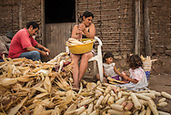 A family shucks corn in front of their home Oct 7, 2014 outside of their home just outside of Santa Rosa de Copan, Honduras. CAMO provides medical needs to thousands in and around Honduras, from general medicine, to gynecological, breast exams, basic dental procedures, neurosurgery, plastic surgery, or ophthalmology. Photo Ken Cedeno