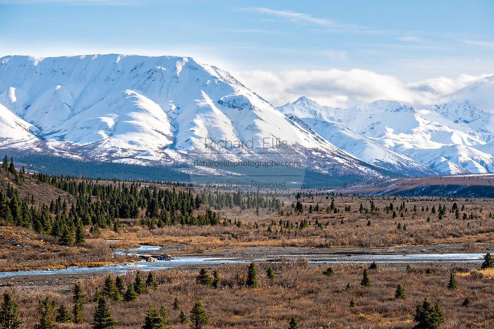 An early season snow dusts the Alaskan Range of mountains in Denali National Park, McKinley Park, Alaska