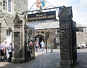 Traditional market place and building with welcome sign, Pannier Market, Tavistock, Devon, England