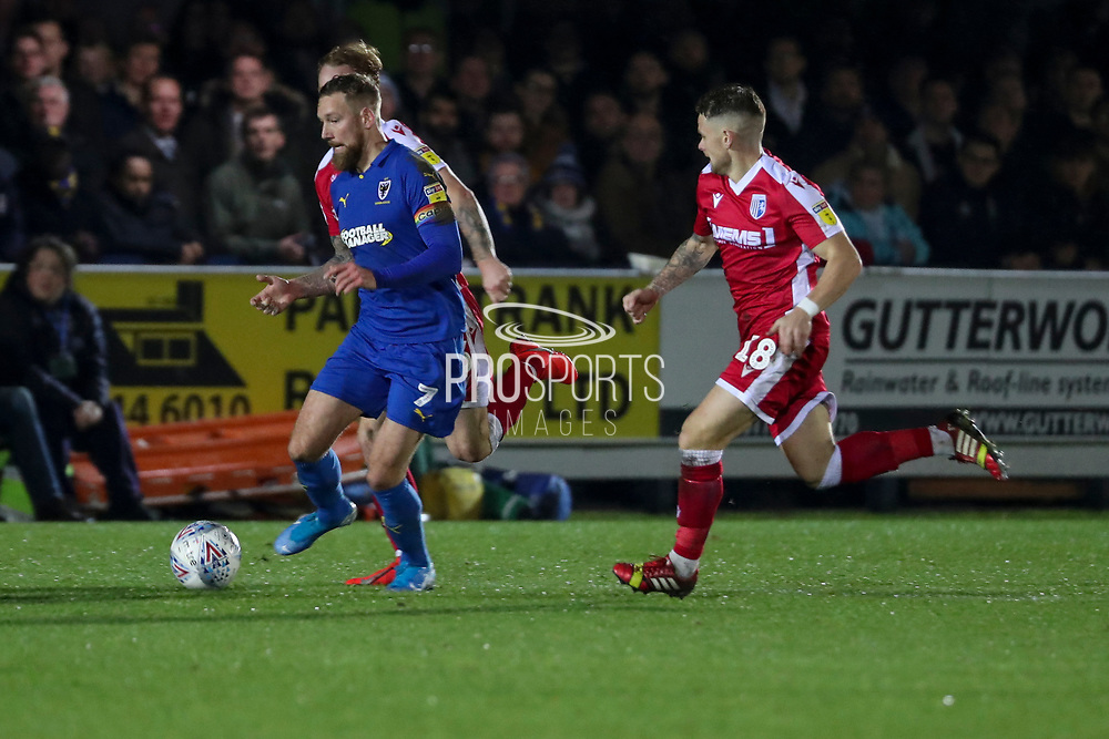 AFC Wimbledon midfielder Scott Wagstaff (7) dribbling during the EFL Sky Bet League 1 match between AFC Wimbledon and Gillingham at the Cherry Red Records Stadium, Kingston, England on 23 November 2019.