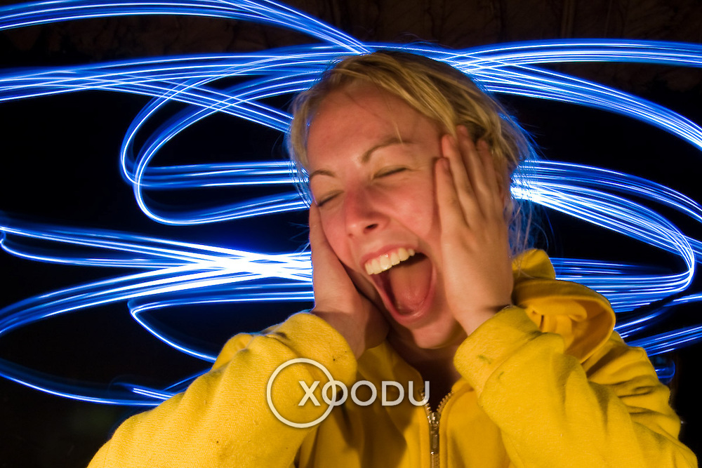 Light painting portrait of young woman screaming (Maewang district, Thailand - Dec. 2008) (Image ID: 081201-1852121a)