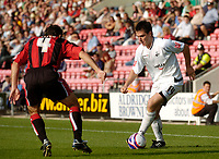 Photo: Leigh Quinnell.<br /> Bournemouth v Swansea City. Coca Cola League 1. 14/10/2007. Swanseas Marcos Painter looks for a way past Bournemouths Paul Telfer.