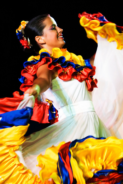 A female dancer from Venezuela performing at a folk dance festival in Tarcento, Italy.
