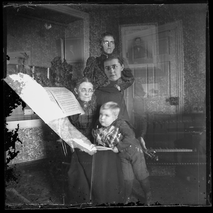 Victorian photograph of a double exposure of three women and a baby