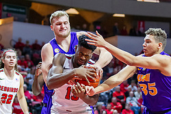 NORMAL, IL - December 31: Rey Idowu gets the ball but is tied up in a held ball situation with Justin Dahl and Noah Carter reach for a loose ball during a college basketball game between the ISU Redbirds and the University of Northern Iowa Panthers on December 31 2019 at Redbird Arena in Normal, IL. (Photo by Alan Look)