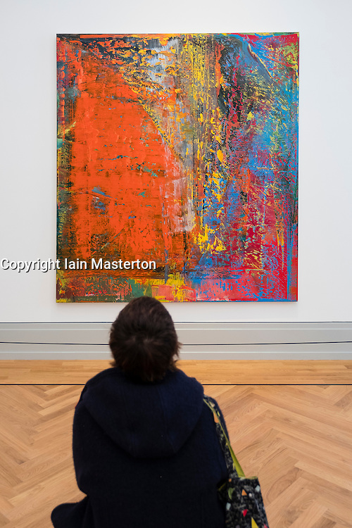 Visitor looking at painting A B Still by Gerhard Richter,  at new Museum Barberini in Potsdam Germany