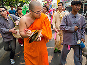 "05 APRIL 2015 - CHIANG MAI, CHIANG MAI, THAILAND: As Buddhist monk plays cymbals and leads a parade during the second day of the three day long Poi Song Long Festival in Chiang Mai. The Poi Sang Long Festival (also called Poy Sang Long) is an ordination ceremony for Tai (also and commonly called Shan, though they prefer Tai) boys in the Shan State of Myanmar (Burma) and in Shan communities in western Thailand. Most Tai boys go into the monastery as novice monks at some point between the ages of seven and fourteen. This year seven boys were ordained at the Poi Sang Long ceremony at Wat Pa Pao in Chiang Mai. Poy Song Long is Tai (Shan) for ""Festival of the Jewel (or Crystal) Sons.    PHOTO BY JACK KURTZ"