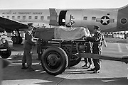 The remains of Corporal Michael Nolan, 35th Battalion, and Trooper Anthony Browne, 33rd Battalion, who lost their lives while serving with the U.N. forces in the Congo, arrived at Dublin Airport. Picture shows the remains of Trooper Browne, draped with the Tricolour and U.N. flags, being transferred from the U.S. plane which brought the coffins from the Congo to a gun carriage.  .15.11.1962