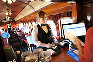 LANSDALE, PA - AUGUST 24: Catherine Keim gets an order for passengers aboard the New Hope and Ivyland Railroad during Founders Day August 24, 2013 in Lansdale, Pennsylvania. The New Hope and Ivyland Railroad made special trips as part of Founders Day from Lansdale to Souderton. (Photo by William Thomas Cain/Cain Images)