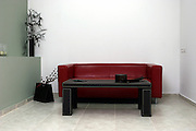 Red leather sofa and coffee table in a waiting room