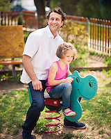 Father and daughter on playground spring rider