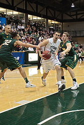 08 March 2014:  Pat Sodemann gets fouled by Izaiah Anderson on his way to the hoop during an NCAA mens division 3 2nd Round Playoff basketball game between the St Norbert Green Knights and the Illinois Wesleyan Titans in Shirk Center, Bloomington IL