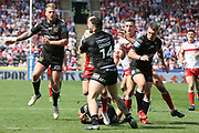 Hull FC outside back Jake Connor (14) stops Hull Kingston Rovers half back Danny McGuire (7)  during the Betfred Super League match between Hull FC and Hull Kingston Rovers at Kingston Communications Stadium, Hull, United Kingdom on 19 April 2019.