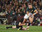 JOHANNESBURG, South Africa, 25 July 2015 : Handré Pollard of the Springboks is tackled by James Broadhurst of the All Blacks during the Castle Lager Rugby Championship test match between SOUTH AFRICA and NEW ZEALAND at Emirates Airline Park in Johannesburg, South Africa on 25 July 2015. Bokke 20 - 27 All Blacks<br /> <br /> © Anton de Villiers / SASPA