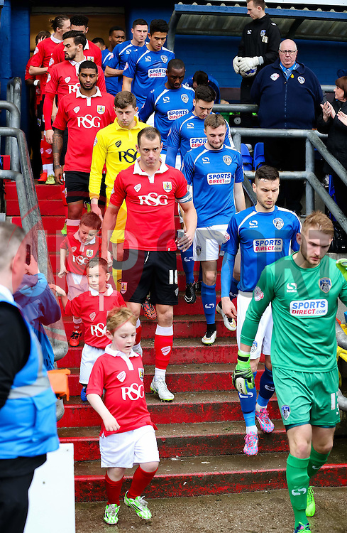 Oldham Athletic & Bristol City walk out of the tunnel with their mascots - Photo mandatory by-line: Matt McNulty/JMP - Mobile: 07966 386802 - 03/04/2015 - SPORT - Football - Oldham - Boundary Park - Oldham Athletic v Bristol City - Sky Bet League One