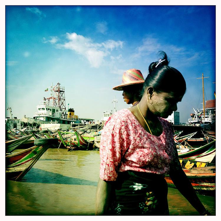 Boats ferry locals across the river from Dallah to Yangon (Rangoon), Myanmar (Burma)