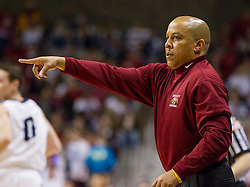 Woodrow Wilson head coach Ronald Kidd calls out a play during a semi-final game at the Charleston Civic Center.