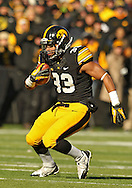 November 23 2013: Iowa Hawkeyes running back Jordan Canzeri (33) tries to make a cut on a run during the first quarter of the NCAA football game between the Michigan Wolverines and the Iowa Hawkeyes at Kinnick Stadium in Iowa City, Iowa on November 23, 2013. Iowa defeated Michigan 24-21.