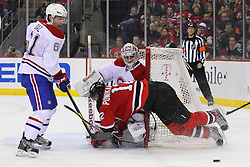 Feb 2; Newark, NJ, USA; New Jersey Devils left wing Alexei Ponikarovsky (12) is tripped by Montreal Canadiens defenseman Raphael Diaz (61) during the second period at the Prudential Center.