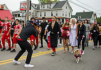 The star studded Senior class with paparazzi in tow bring glitz and glamour from Hollywood to the streets of Laconia during Laconia's Homecoming parade Friday afternoon.  (Karen Bobotas/for the Laconia Daily Sun)